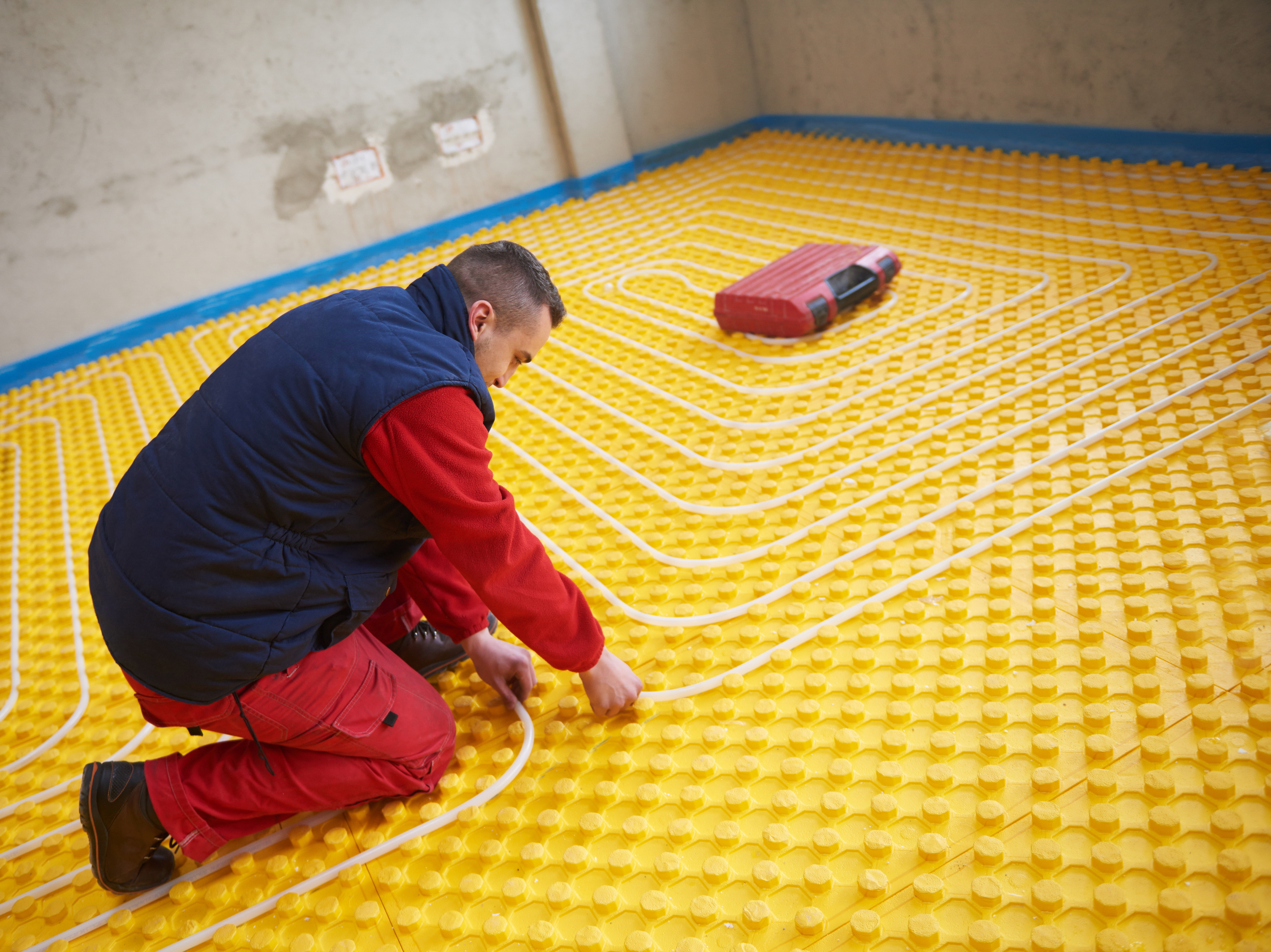 group of workera installing underfloor heating and colling in modern h